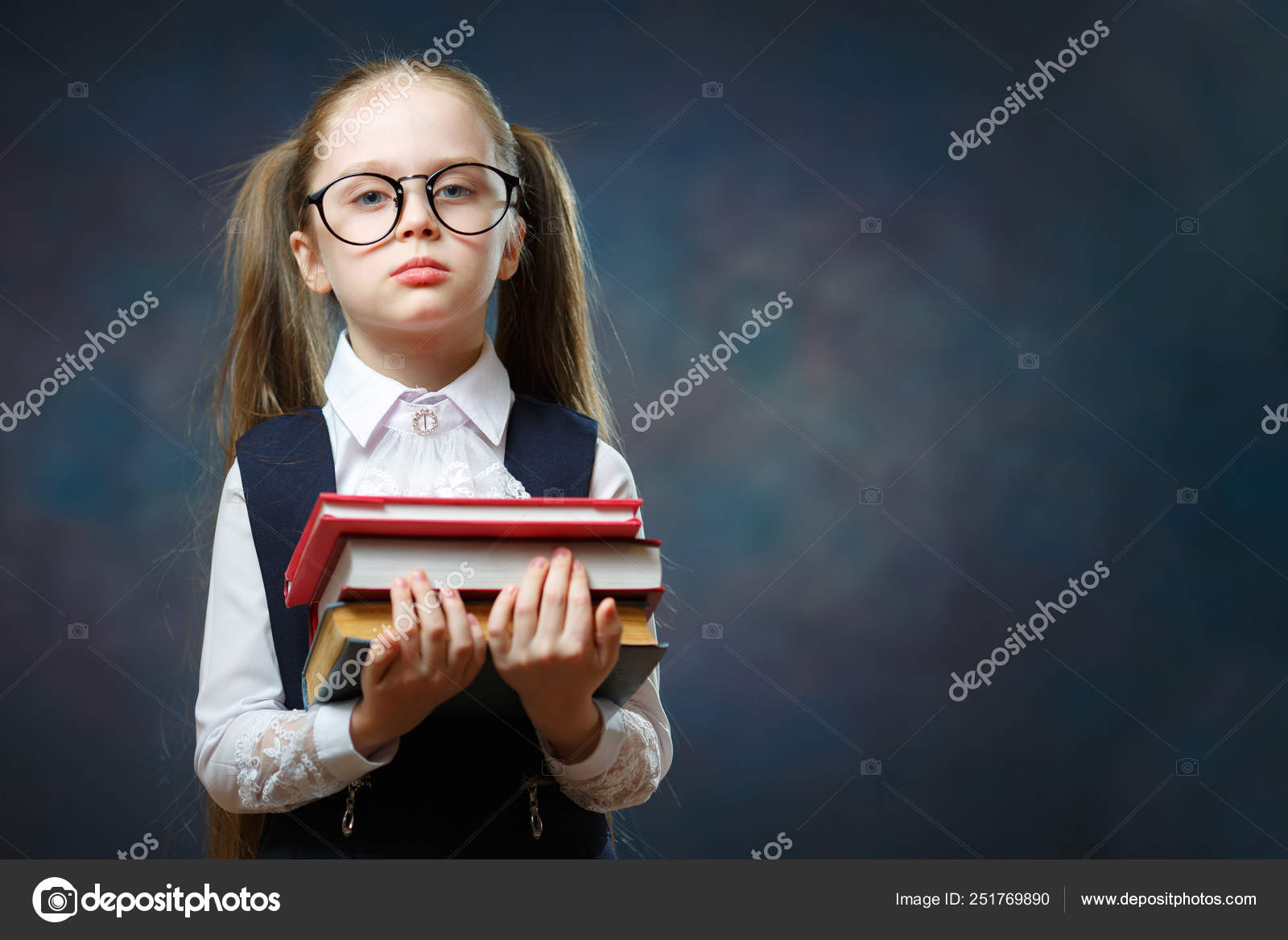 be2f9d7efb83 Serious Schoolgirl Wear Glasses Hold Pile of Book. Adorable Smart  Elementary School Student in Big Spectacle. Clever Little Caucasian Girl.