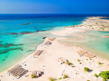 Aerial view of Elafonissi beach on Crete island with azure clear water, Greece, Europe. Crete is the largest and most populous of the Greek islands.