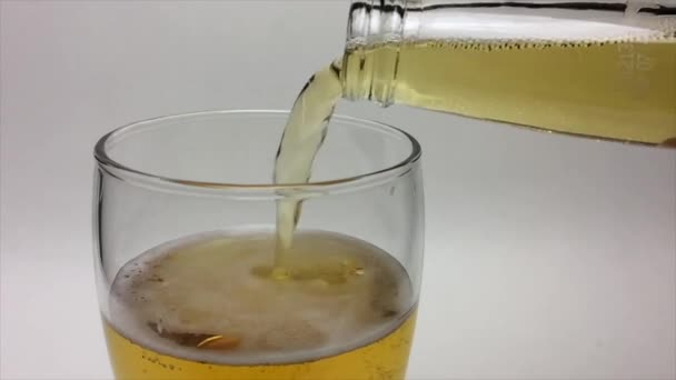 Light Beer Pouring From Beer Bottle