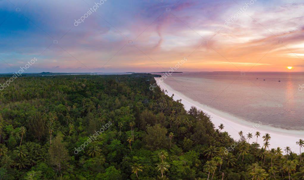 Aerial view tropical beach island reef caribbean sea dramatic sky at sunset sunrise. Indonesia Moluccas archipelago, Kei Islands, Banda Sea. Top travel destination, diving snorkeling