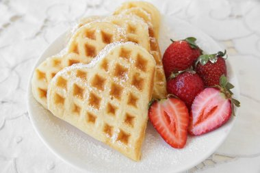 waffles with fresh strawberries, selective focus