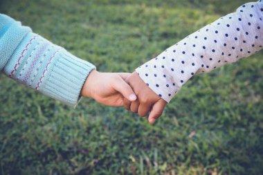 Multi-ethnic children holding hands for peace, diversity, friendship concept