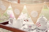 Photo vintage bunting and tea set, Alice in wonderland Mad Hatters tea party, toning