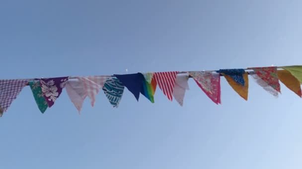 slow motion of colorful vintage bunting in festive summer fair