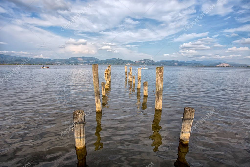 Wood pier in Torre del Lago Puccini, Pisa, Tuscany, Italy