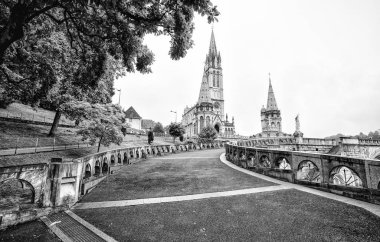 LOURDES, FRANCE - JUNE 10, 2016: Notre Dame du Rosaire de Lourdes (Basilica of our Lady of the Rosary) the roman Catholic church in Lourdes, France, in June 10, 2016