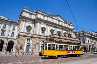 MILAN, ITALY, JUNE, 7, 2017 - Teatro alla Scala (Theatre La Scala) with a typical Milan old tram. Is the main opera house in Milan. Considered one of the most prestigious theaters in the world, Milan, Italy