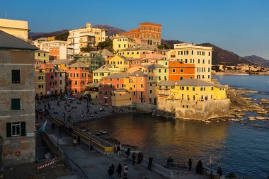 GENOA, ITALY, MARCH 23, 2019 - View of Genoa Boccadasse at sunset, a fishing village of colorful houses, in Genoa, Italy.