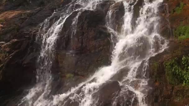 Cascade waterfall in picturesque jungle rainforest