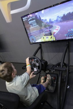 Moscow - August 26, 2016: Gamer driving autosimulator at the Moscow International Automobile Salon, MIAS. Public-event.
