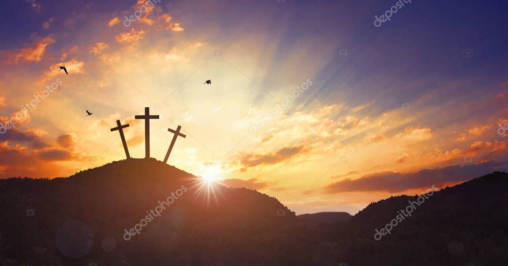 Christmas concept: Crucifixion Of Jesus Christ Cross At Sunset