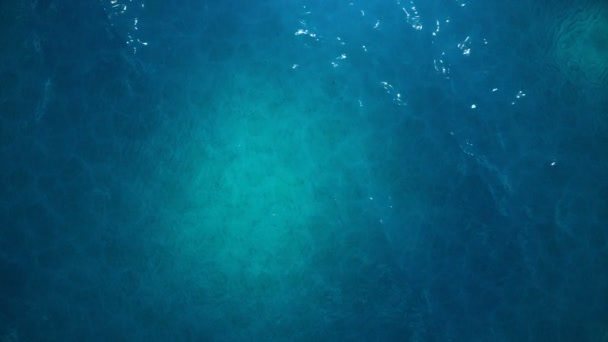 Sea or ocean, waves close-up view. Blue waves sea water. Blue crystal clear water. One can see the sandy seabed. Sea waves top view. 3D 4K animation