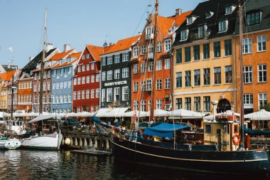 Panoramic view of colorful houses on bank and boats in Nyhavn canal , Copenhagen, Denmark stock vector