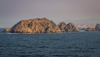 Lovely exposure of the city of Muscat at Sunrise, view from a Ship.