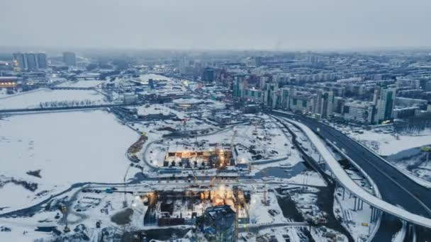 Aerial drone timelapse view of construction site cranes machines; new segment of road junction; development of modern infrastructure Chelyabinsk; panoramic cityscape; Shanghai cooperation organization