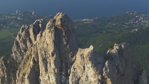 Amazing Aerial View. Flight over the rock peak of the mountain Ai-Petri. Super slow motion. Crimea Yalta city. Summer day time.