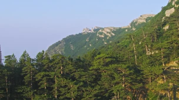 Amazing Aerial View. Flight over the rock peak of the Crimean mountain. Summer sunset time. Super slow motion.