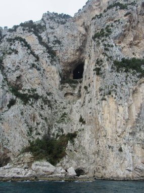 View of the cave and cliff near Emperor Tiberius' Villa Jovis, which is believed to have been an execution spot, on Capri, Italy