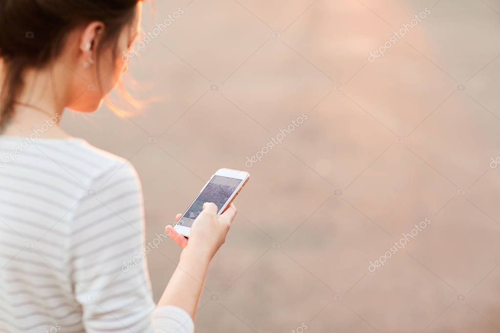 The girl looks through social networks on your phone