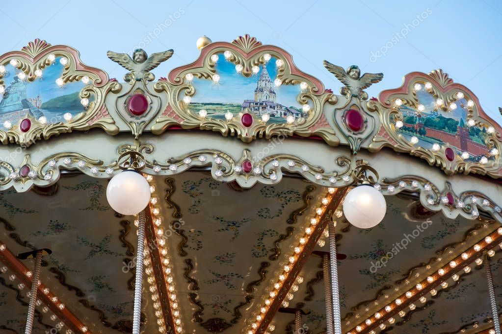 Children's carousel in the center of Moscow. Two-storey carousel with horses