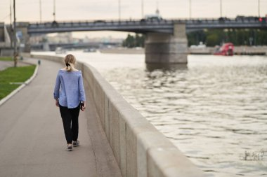 Moscow, Russia - August 09, 2019: A girl walks along the embankment of Moscow