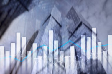 Financial graphs and charts on blurred business center background. Investment and trading concept.