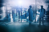 Double exposure Economics growth diagrams on blurred background. Business and investment concept.