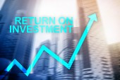 Fotografie ROI - Return on investment. Stock trading and financial growth concept on blurred business center background.