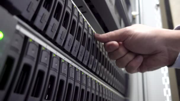 IT Engineer install hard drive in server rack. Cluster Server Data Room. Detailed and Technically Accurate Footage close up. Concept 3.0.