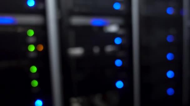 Server room. Web internet and network telecommunication technology, big data storage supercomputer. Motion shot. Blured background.