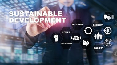 Sustainable development, ecology and environment protection concept. Renewable energy and natural resources. Double exposure of success businessman with abstract building.