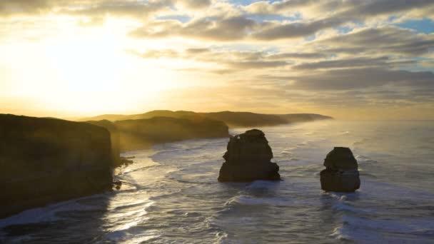 Coastal visitor attraction by Great Ocean Road Twelve Apostles Marine National Park limestone cliffs at sunrise Victoria Australia
