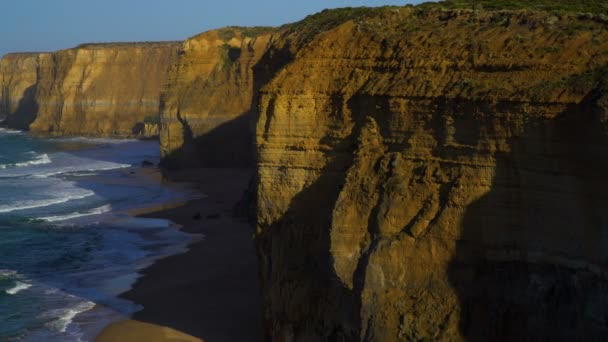 Great Ocean Road coastal tourist attraction limestone cliffs and Twelve Apostles rock formations Shipwreck Coast Victoria Australia