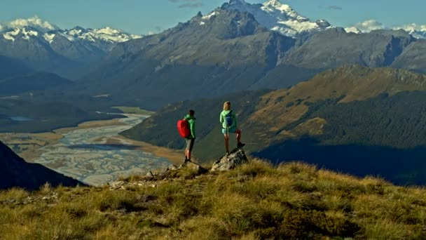 Aerial drone view of fit Caucasian male and female team outdoor planning adventure trip in Mount Aspiring New Zealand