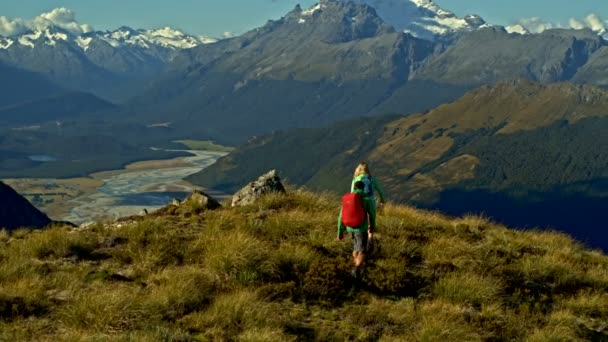 Aerial drone view of young Caucasian adventure hikers enjoying hiking in clean landscape of South Island New Zealand