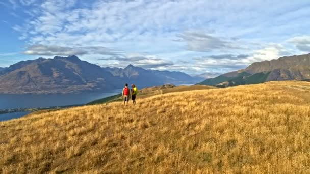Aerial drone of fit Caucasian adventure travellers hiking nature in Mount Aspiring National Park South Island New Zealand