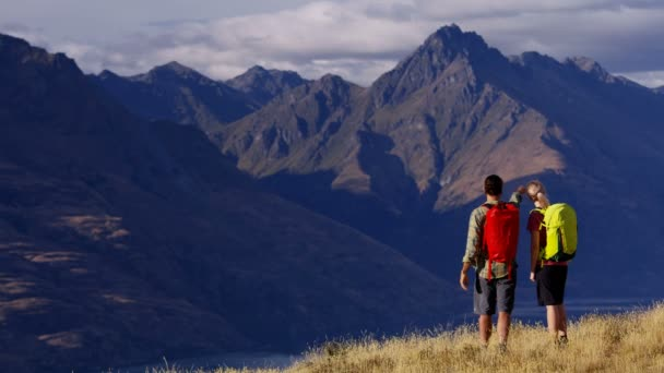 Young Caucasian male and female hikers on their hiking adventure trip in The Remarkables Otago New Zealand