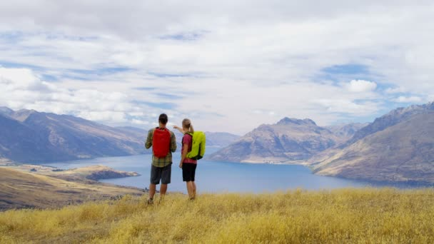 Young Caucasian adventure couple on their vacation trekking of The Remarkables Lake Wakatipu Otago New Zealand