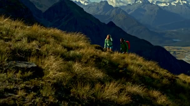 Aerial drone view of active Caucasian adventure hikers outdoor trekking nature of Mt Aspiring South Island New Zealand