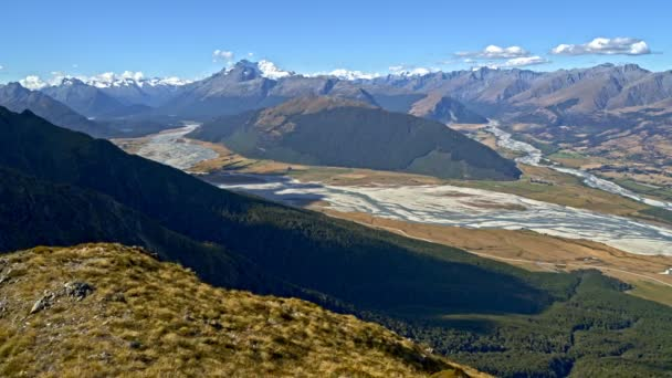 Aerial drone view of healthy Caucasian adventure female traveller achieving her ambitions hiking Mt Aspiring National Park New Zealand