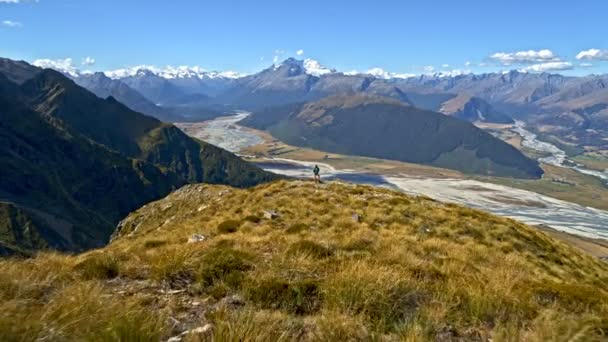 Aerial drone of young Caucasian adventure female hiker with backpack enjoying hiking in landscape of South Island New Zealand