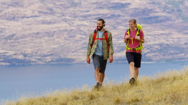 Young Caucasian male and female outdoor enjoying walking in nature of Fjordland The Remarkables New Zealand