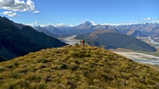 Aerial drone of fit Caucasian couple on their hiking adventure expedition in Mt Aspiring National Park New Zealand