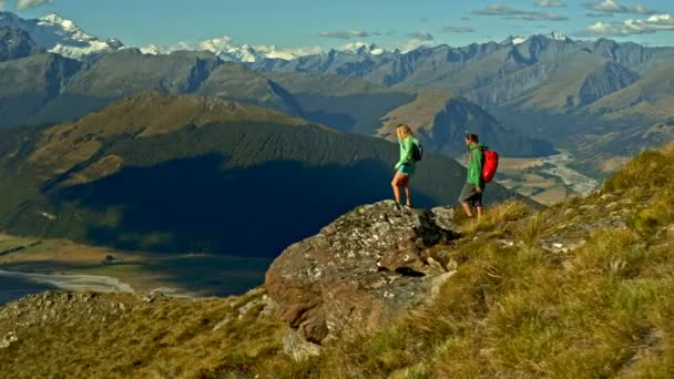 Aerial drone of active healthy Caucasian male and female trekking nature of Mt Aspiring South Island New Zealand