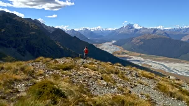 Aerial drone of young Caucasian adventure male traveller trekking nature in Mt Aspiring National Park South Island New Zealand