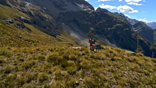 Aerial drone of healthy Caucasian hikers on their hiking adventure expedition in Mount Aspiring National Park New Zealand