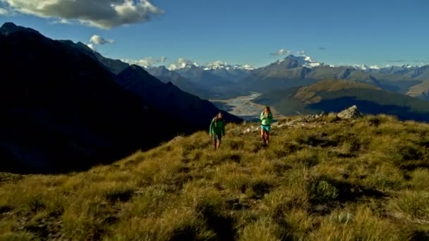 Aerial drone view of active young Caucasian hikers outdoors on their vacation hiking Fjordland National Park South Island
