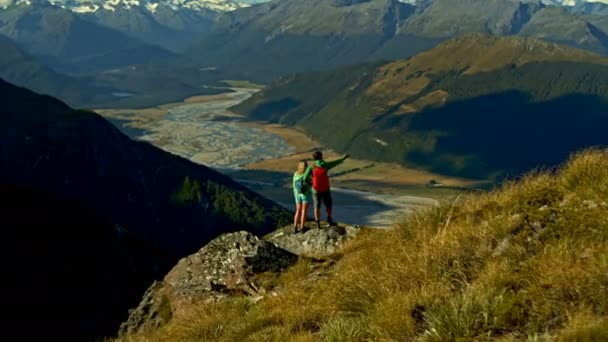 Aerial drone view of active young Caucasian couple outdoor on their vacation hiking Fjordland National Park New Zealand