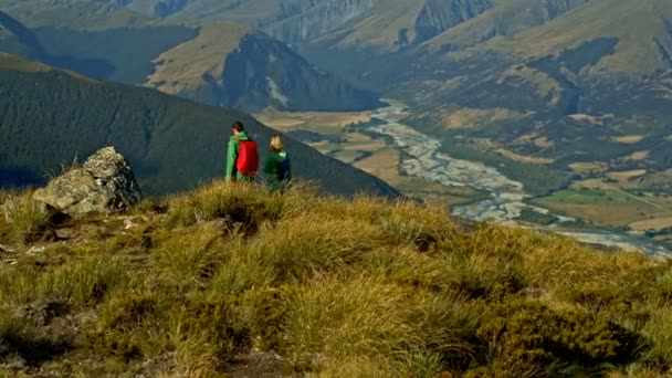 Aerial drone view of fit Caucasian male and female team outdoor enjoying adventure expedition in South Island New Zealand
