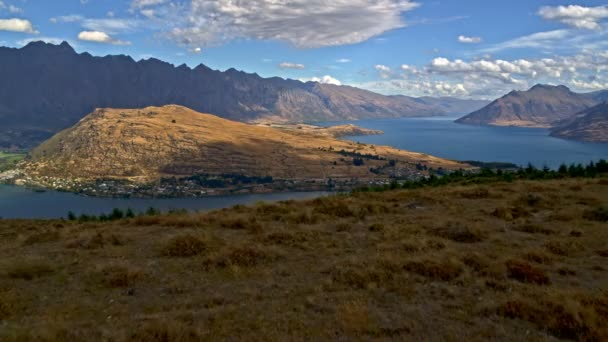 Aerial drone of active Caucasian seniors with backpacks hiking to keep fit of Fjordland Lake Wakatipu Otago New Zealand